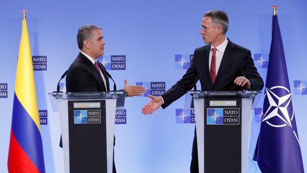Iván Duque, presidente de Colombia, y Jens Stoltenberg, secretario General de la OTAN - Sputnik Mundo
