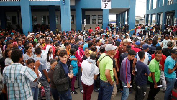 Los migrantes venezolanos - Sputnik Mundo