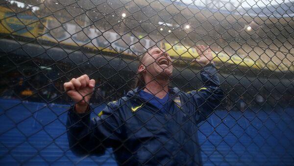 Un hincha de Boca Juniors - Sputnik Mundo