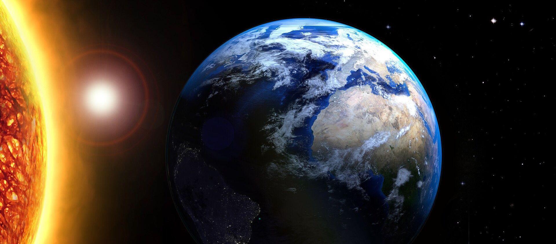 La Tierra y el sol - Sputnik Mundo, 1920, 03.06.2020