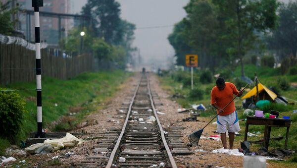 Un migrante venezolano - Sputnik Mundo