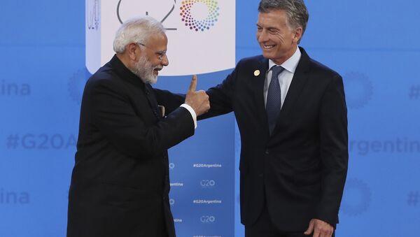 Narendra Modi, primer ministro de la India, y Mauricio Macri, presidente de Argentina - Sputnik Mundo