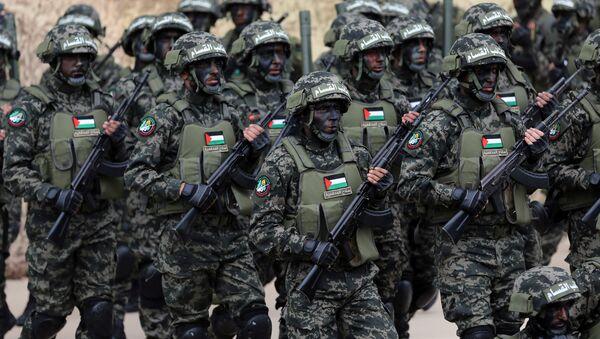Militantes del movimiento Hamás durante el 31 aniversario de la organización - Sputnik Mundo