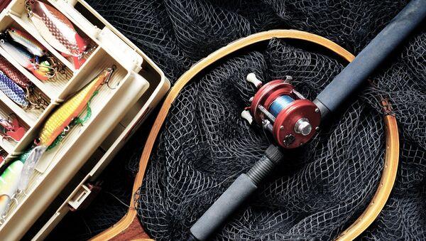 Una caña y la red para pescar (imagen referencial) - Sputnik Mundo