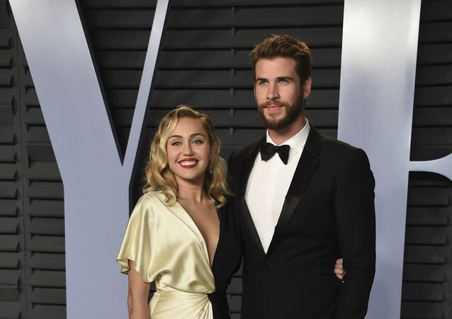 Miley Cyrus, cantante, y su pareja, el actor Liam Hemsworth