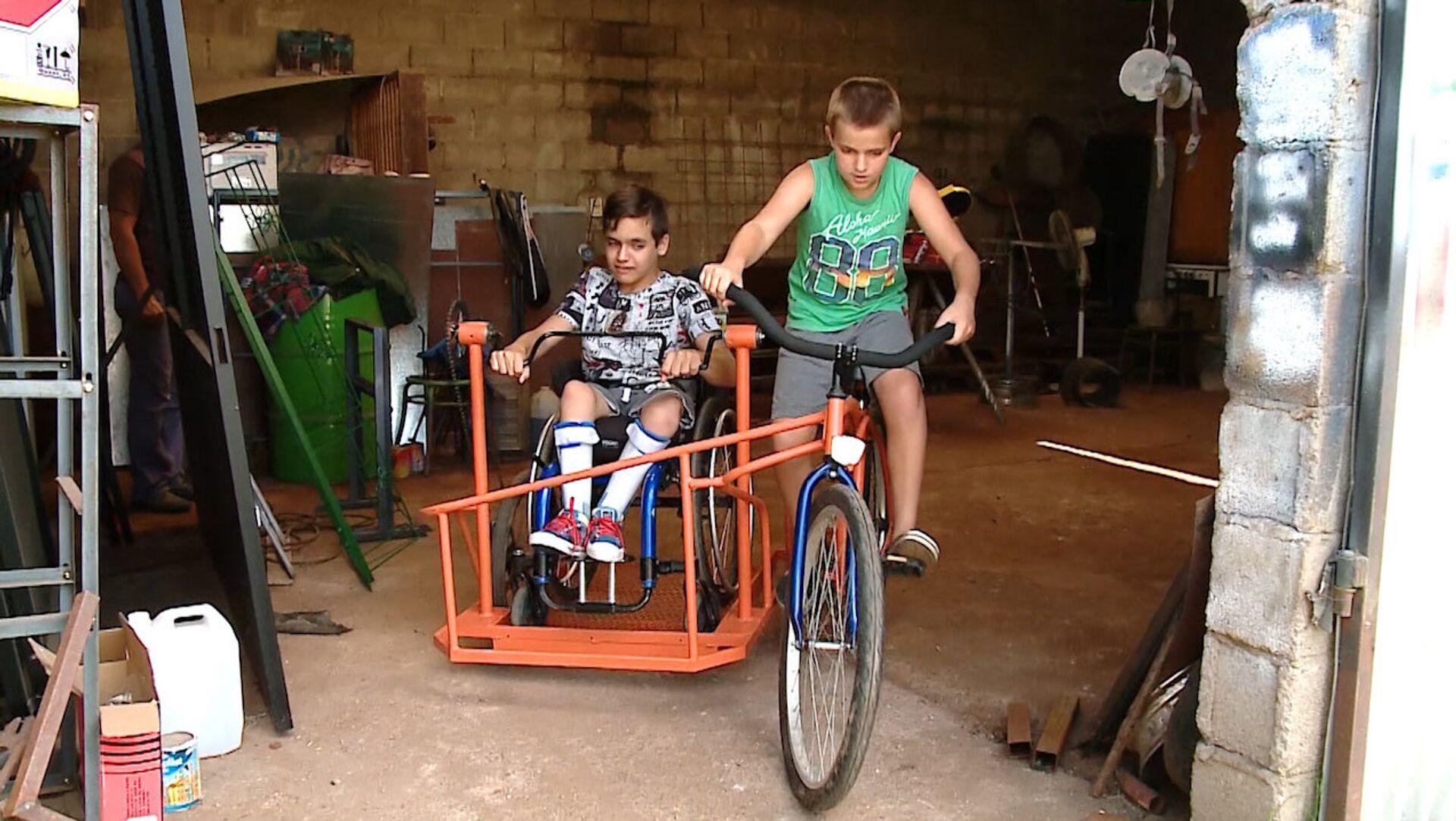 Un sueño hecho realidad: un niño argentino con discapacidad podrá 'pasear' en bicicleta - Sputnik Mundo, 1920, 09.01.2019