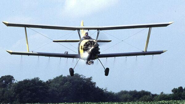Una avioneta de fumigación - Sputnik Mundo