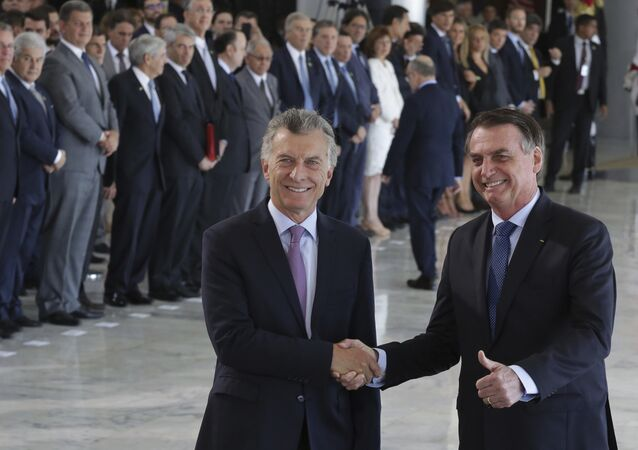 El presidente de Argentina, Mauricio Macri, con su par brasileño, Jair Bolsonaro (archivo)