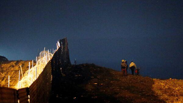 Los migrantes en la frontera entre México y EEUU - Sputnik Mundo