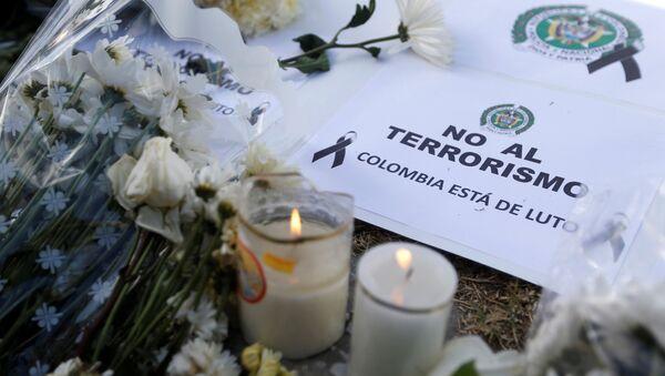 Homenaje a las víctimas del atentado en Bogotá - Sputnik Mundo