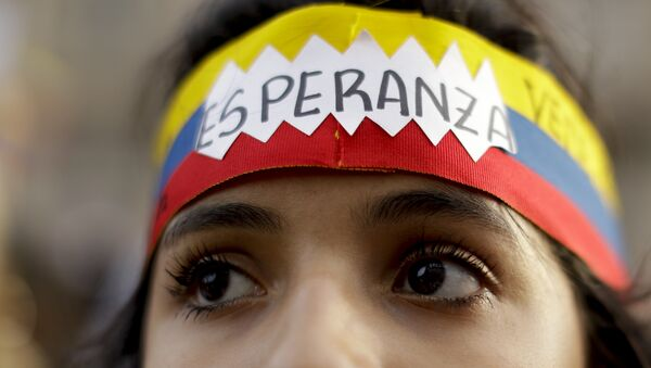 Una manifestante venezolana - Sputnik Mundo