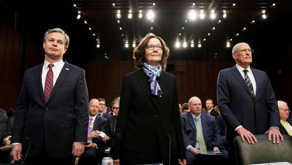 El director de Inteligencia Nacional, Dan Coats, la directora de la CIA, Gina Haspel, y el director del FBI, Christopher Wray - Sputnik Mundo