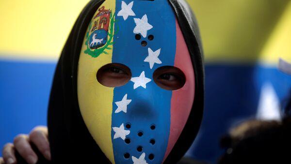 Una máscara con la bandera de Venezuela - Sputnik Mundo