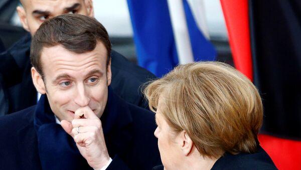 La canciller alemana, Angela Merkel, y el presidente francés, Emmanuel Macron - Sputnik Mundo