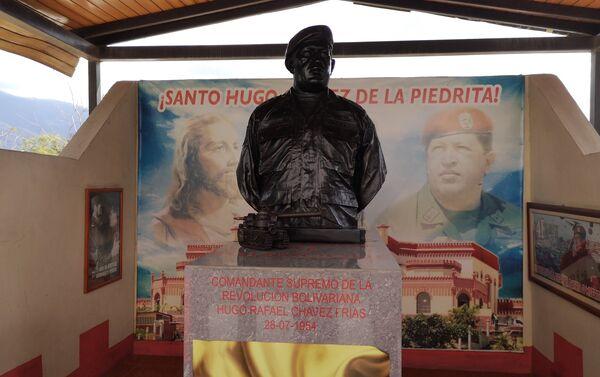 Monumento en memoria a Hugo Chávez, en la comunidad de La Piedrita - Sputnik Mundo
