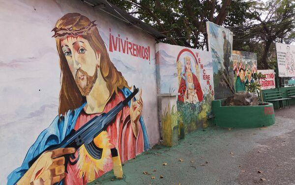 Mural con imágenes religiosas alusivas de Jesúscristo y la Virgen de Coromoto - Sputnik Mundo