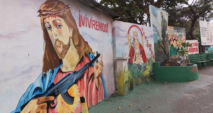 Mural con imágenes religiosas alusivas de Jesúscristo y la Virgen de Coromoto