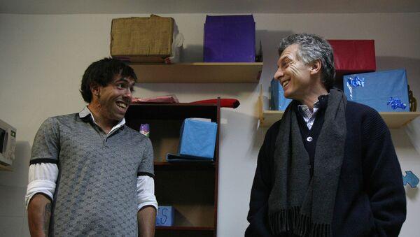 El jugador de fútbol Carlos Tévez y el presidente de Argentina, Mauricio Macri - Sputnik Mundo