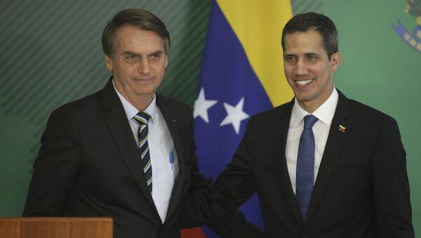 El presidente de Brasil, Jair Bolsonaro, y el autoproclamado presidente encargado de Venezuela, Juan Guaidó - Sputnik Mundo