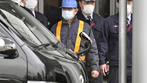 Carlos Ghosn, exjefe del consorcio automovilístico Nissan (centro) - Sputnik Mundo