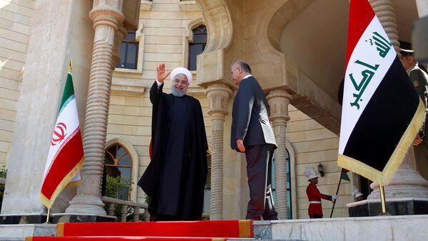 El presidente de Irán, Hasán Rohaní, con su homólogo iraquí, Barham Saleh - Sputnik Mundo