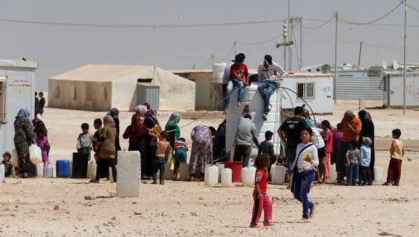 Un campo de refugiados en Siria - Sputnik Mundo