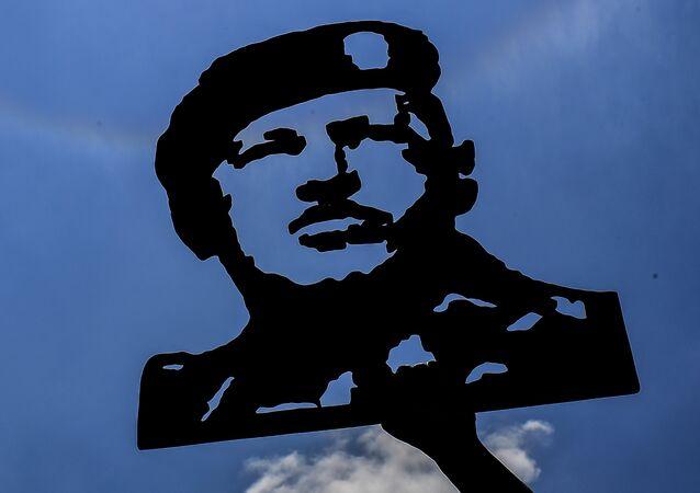 Imagen de Hugo Chávez, expresidente de Venezuela, en una manifestación a favor de Nicolás Maduro, actual mandatario del país