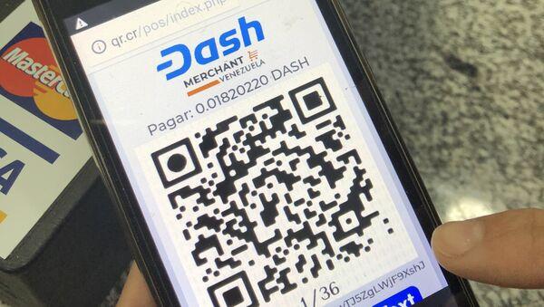 Con un código QR, se genera un pago con criptomonedas en la plataforma Dash, utilizada en algunos comercios de Venezuela - Sputnik Mundo