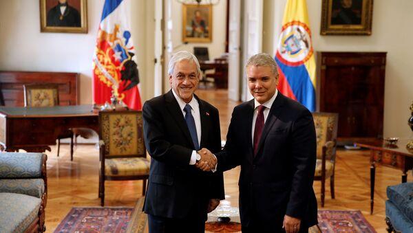El presidente de Colombia, Iván Duque, y su homólogo chileno, Sebastián Piñera, en Santiago, Chile - Sputnik Mundo