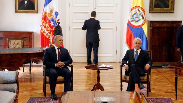 El presidente de Colombia, Iván Duque, y su homólogo chileno, Sebastián Piñera - Sputnik Mundo