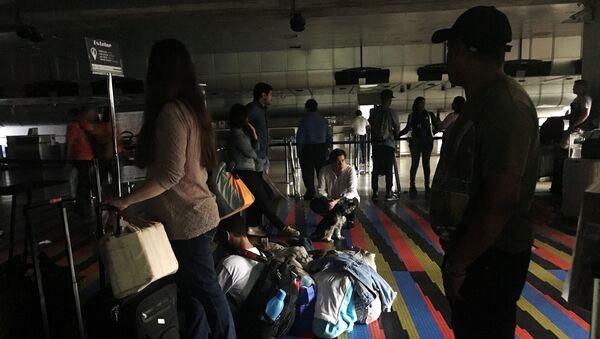 Aeropuerto internacional Simón Bolívar durante el apagón en Caracas, Venezuela - Sputnik Mundo