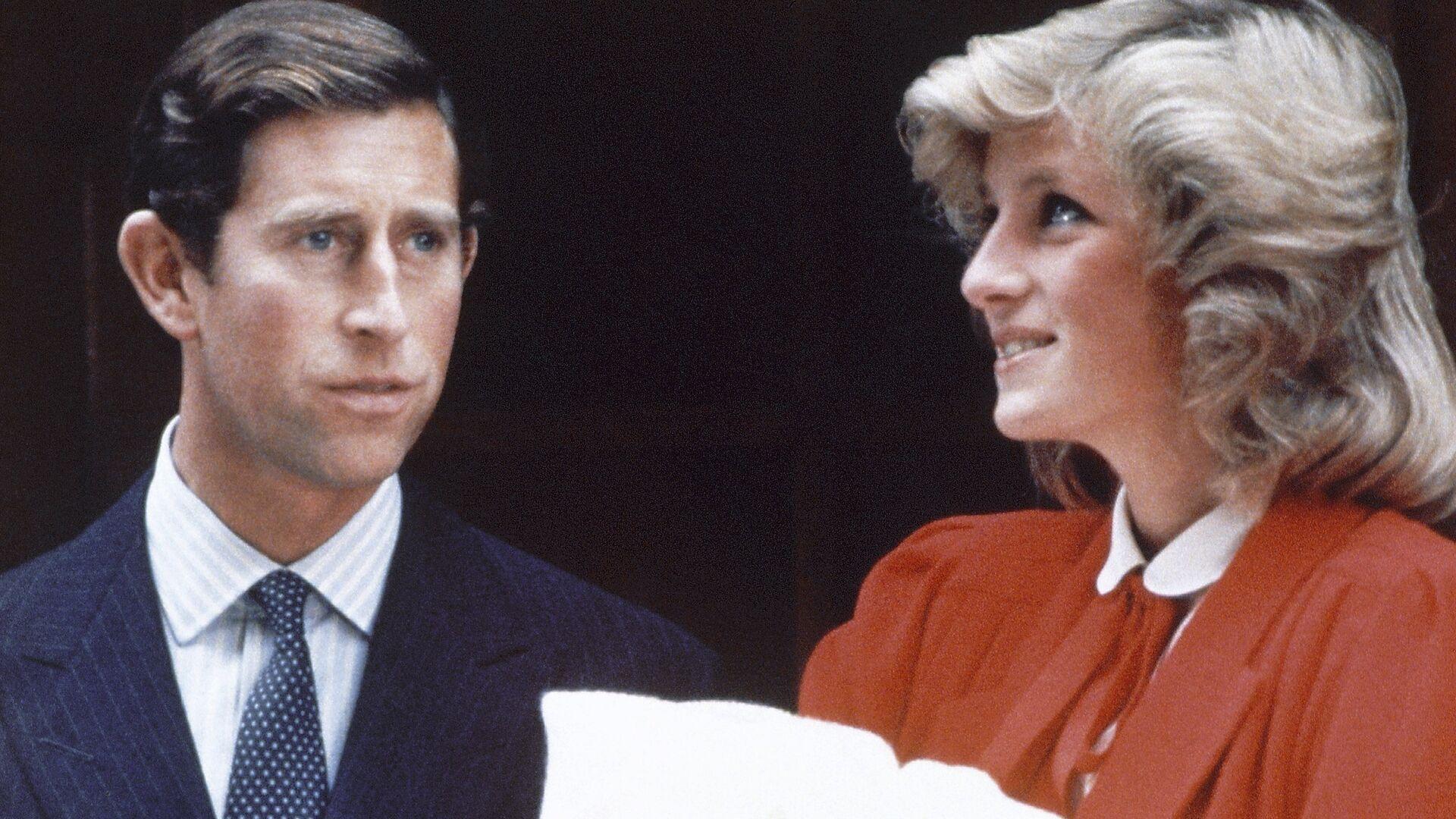 La princesa Diana y el príncipe Carlos con un hijo suyo - Sputnik Mundo, 1920, 30.06.2021