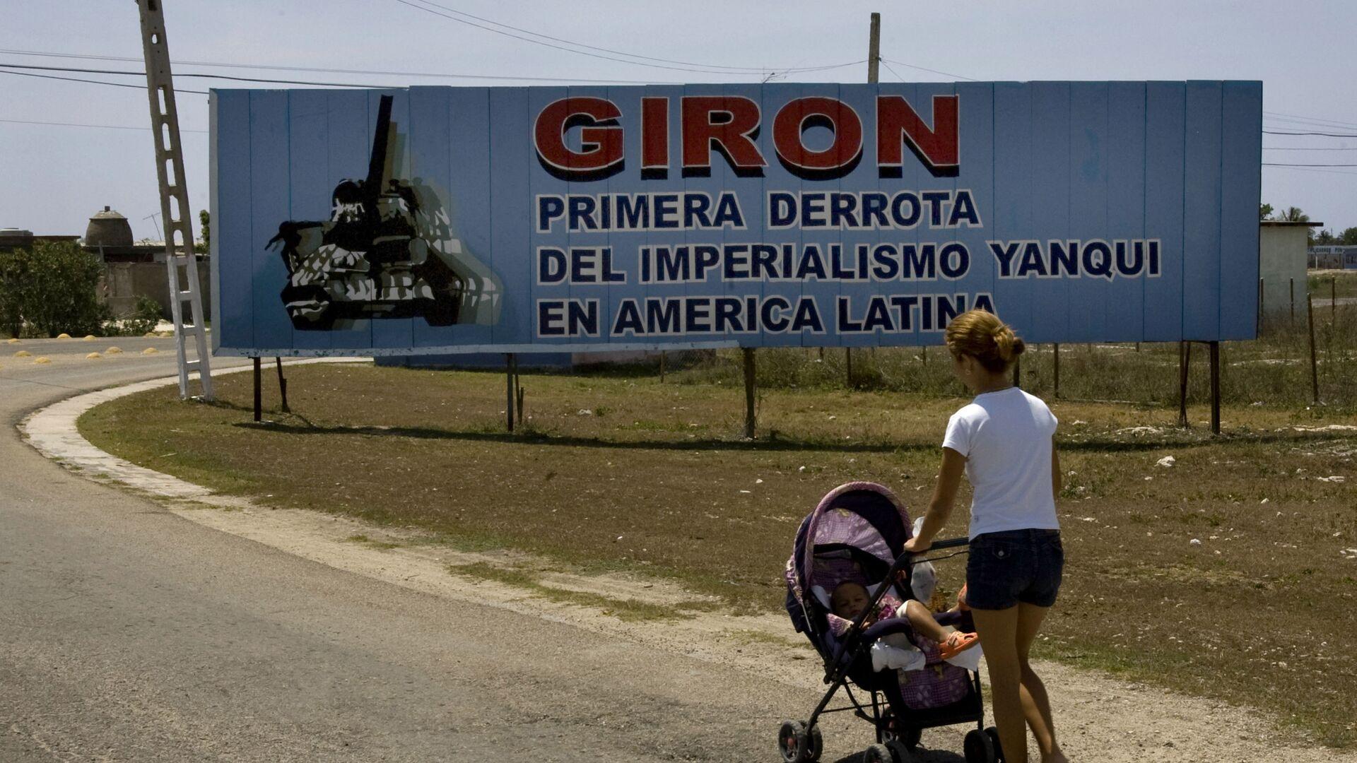 Cartel ubicado a la entrada del municipio Girón, en Matanzas, Cuba - Sputnik Mundo, 1920, 15.04.2021