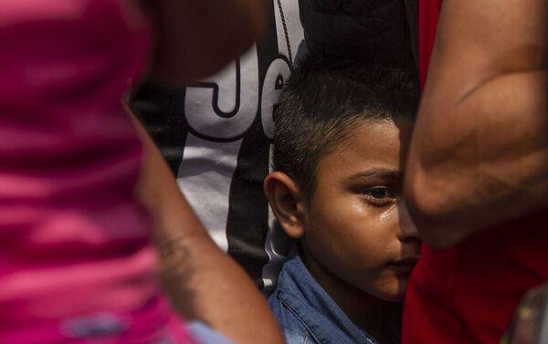 Tapachula, Chiapas. Niño durante el camino del Vía Crucis cubano que alquilo autobuses para llegar a la frontera norte - Sputnik Mundo