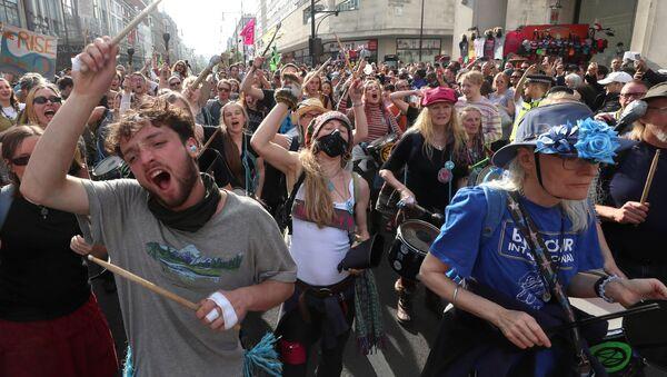 Activistas contra el cambio climático se manifiesta en Londres - Sputnik Mundo