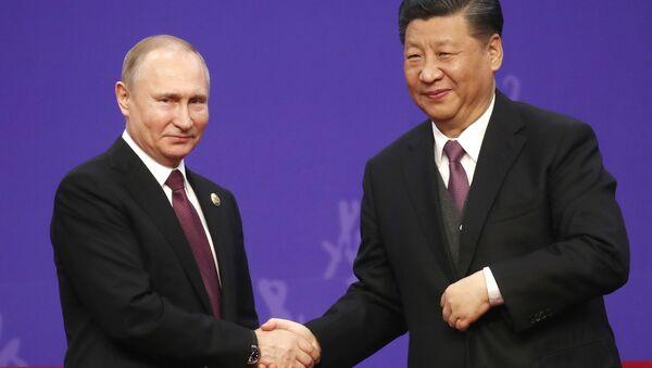 El presidente de Rusia, Vladímir Putin, y el presidente de China, Xi Jinping - Sputnik Mundo