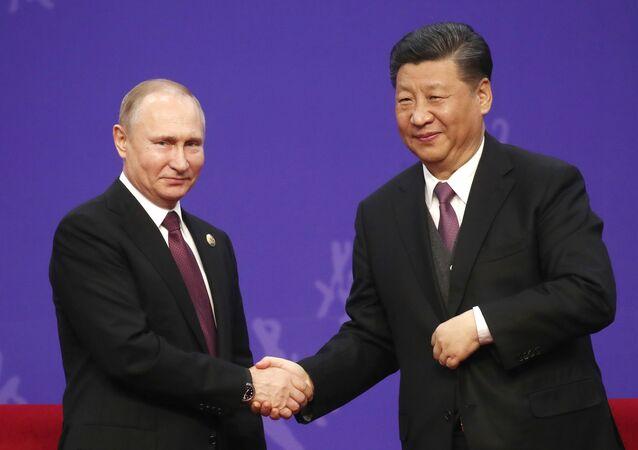El presidente de Rusia, Vladímir Putin, y el presidente de China, Xi Jinping