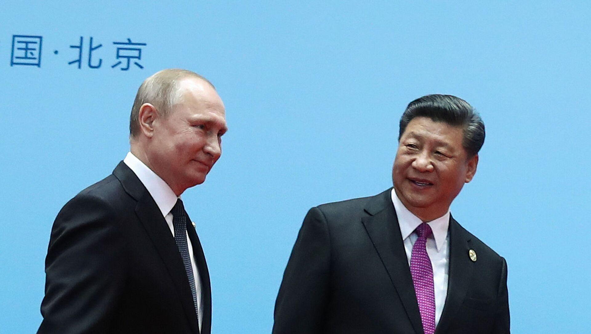 El presidente de Rusia, Vladímir Putin, y el presidente de China, Xi Jinping - Sputnik Mundo, 1920, 03.10.2020