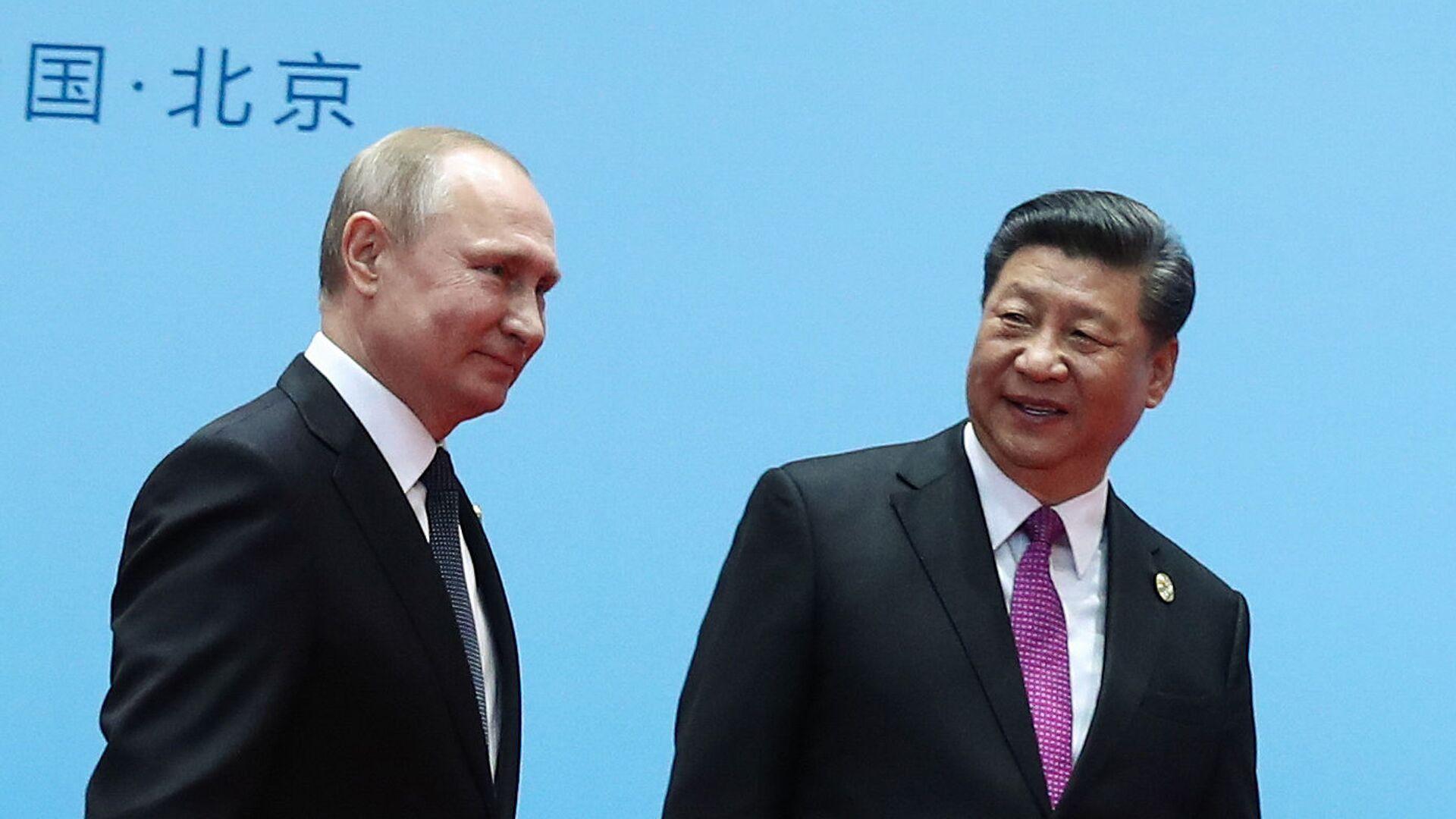 El presidente de Rusia, Vladímir Putin, y el presidente de China, Xi Jinping - Sputnik Mundo, 1920, 18.05.2021