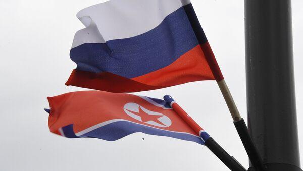 Las banderas de Rusia y Corea del Norte - Sputnik Mundo