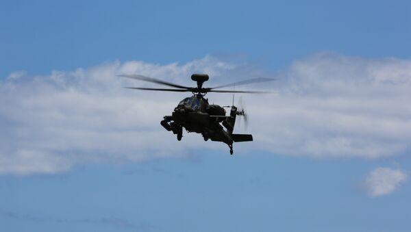 Un AH-64E Apache - Sputnik Mundo