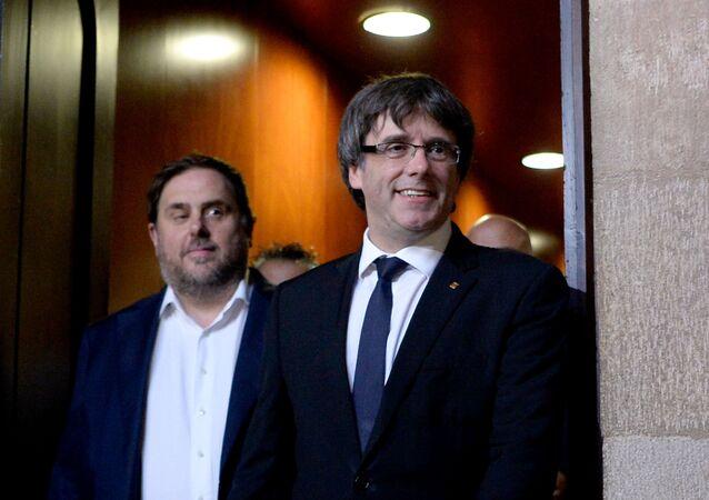 Exdirigentes catalanes Oriol Junqueras y Carles Puigdemont