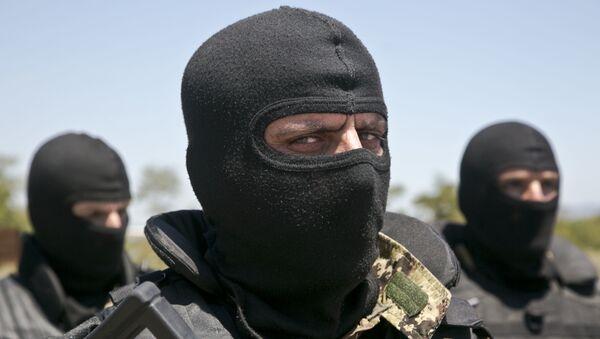 Un militar de Kosovo - Sputnik Mundo