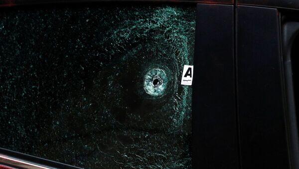Disparo en el vidrio de un automóvil en México - Sputnik Mundo