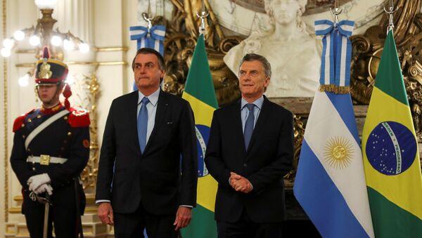El presidente de Brasil, Jair Bolsonaro, con su par argentino, Mauricio Macri - Sputnik Mundo