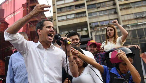 El líder opositor venezolano Juan Guaidó en un acto en Caracas - Sputnik Mundo