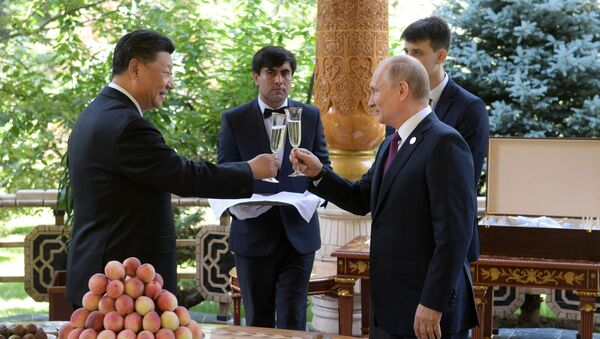 El presidente ruso, Vladímir Putin, y su homólogo chino, Xi Jinping - Sputnik Mundo