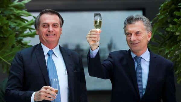 El presidente de Brasil, Jair Bolsonaro, junto a su homólogo argentino, Mauricio Macri - Sputnik Mundo