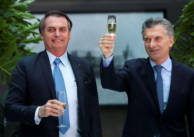 El presidente de Brasil, Jair Bolsonaro, junto a su homólogo argentino, Mauricio Macri