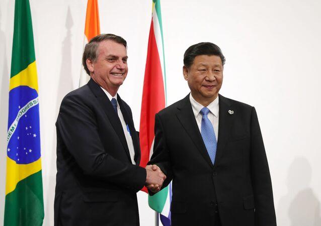 El presidente de Brasil, Jair Bolsonaro junto al presidente de China Xi Jinping (archivo)